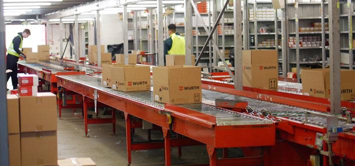 Automated warehouse conveyor